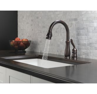 Delta-978-DST-Running Faucet in Spray Mode in Venetian Bronze