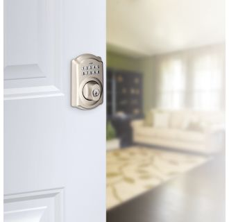 Schlage's BE365-CAM in Satin Nickel on door.